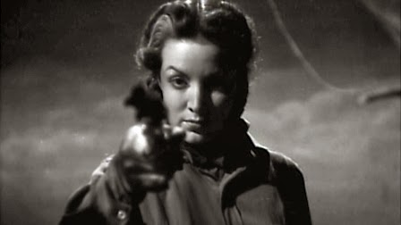 image of woman with gun from fernando de fuentes film dona barbara