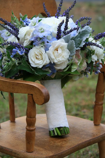 hydrangea, white garden roses, spray roses,white ranuculas, delphinium, fresh lavender, blue tweedia, and dusty miller Bridal Bouquet - Splendid Stems Floral Designs