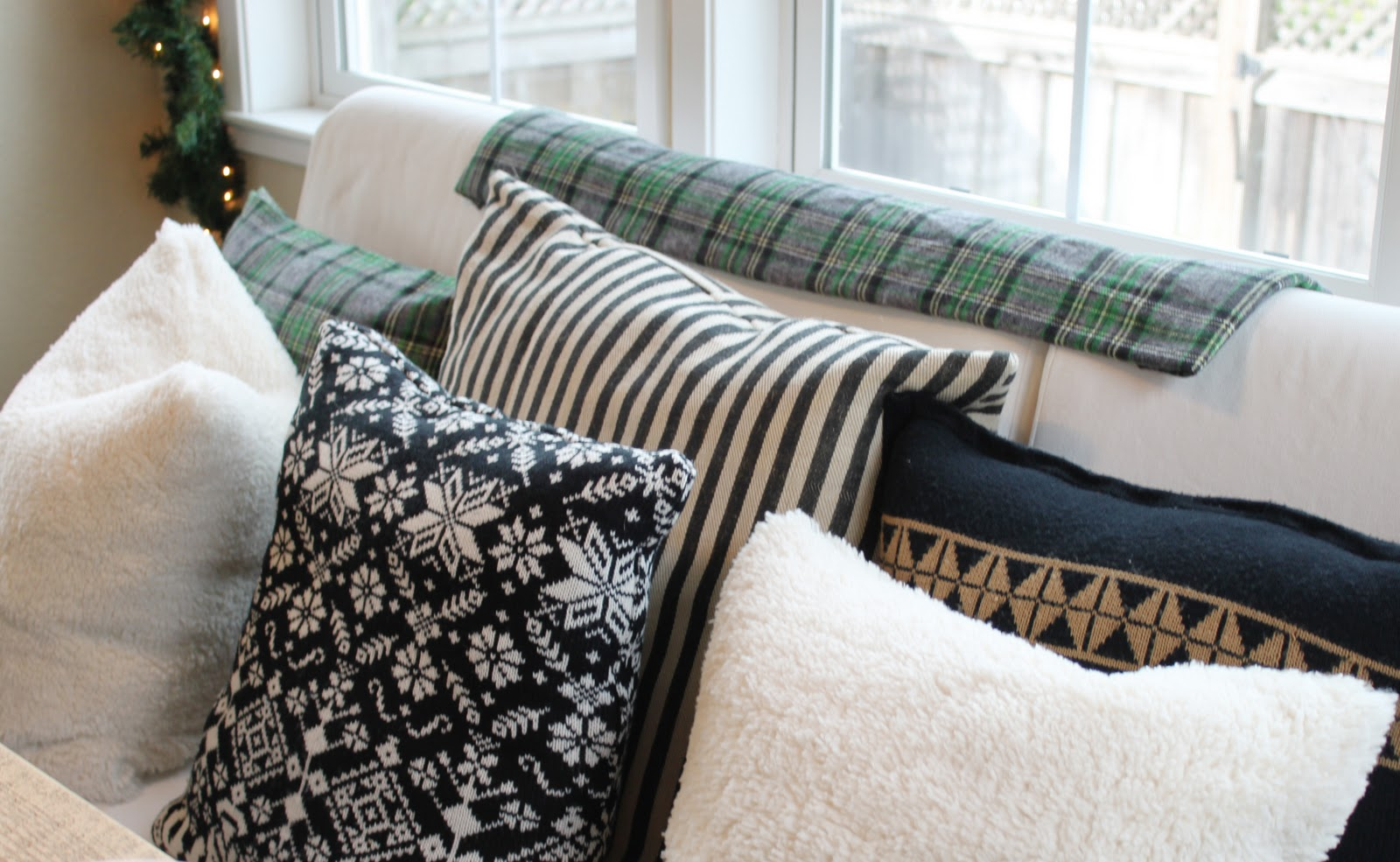 a little glass box: Sweater pillows & table sneak peak