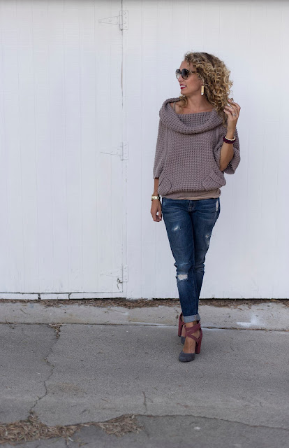 chunky sweater distressed jeans and heels