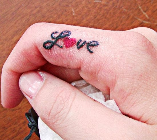 Love Tattoo On Finger