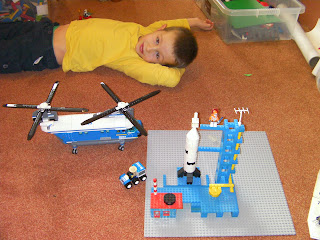 lego rocket with launchpad and radar tower