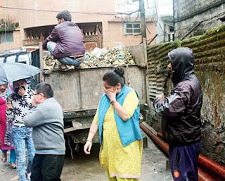 Workers clean garbage in Darjeeling municipality