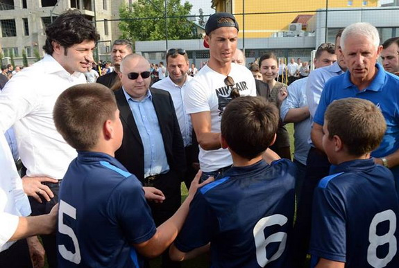 Cristiano Ronaldo chats with children at the inauguration of a new football academy in Tbilisi