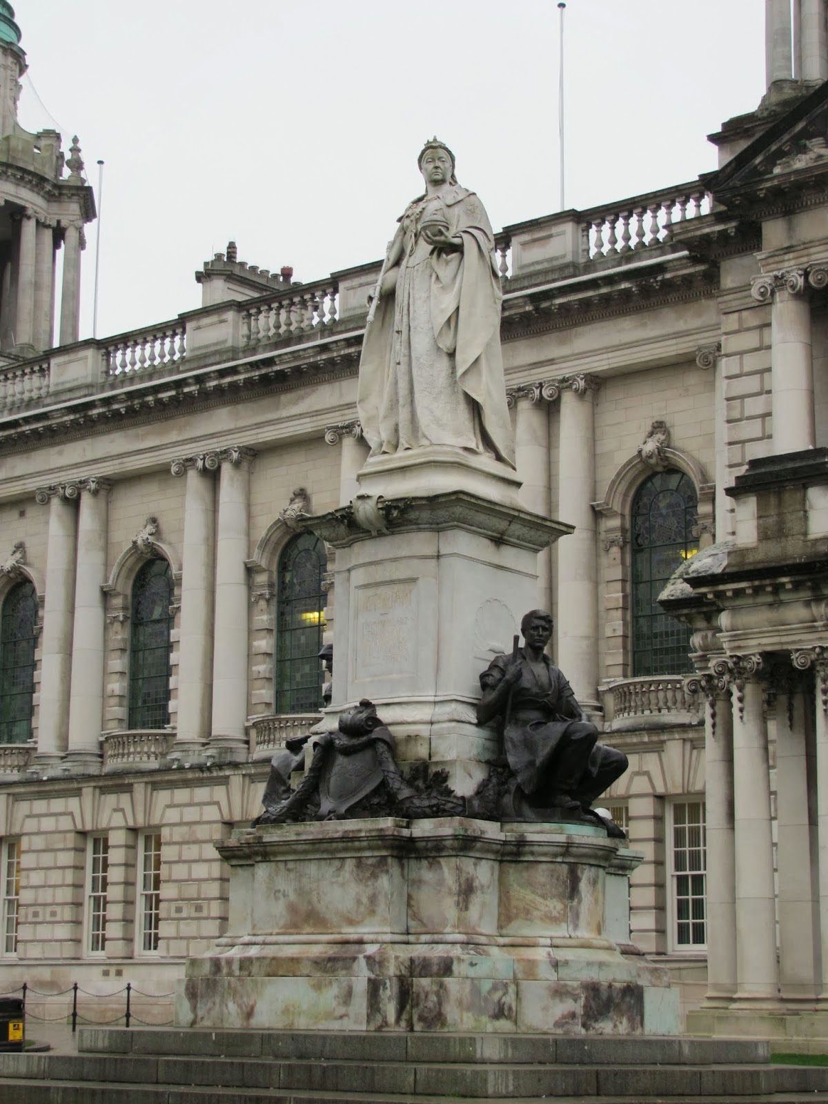 Queen Victoria stands above the people in Belfast, Northern Ireland