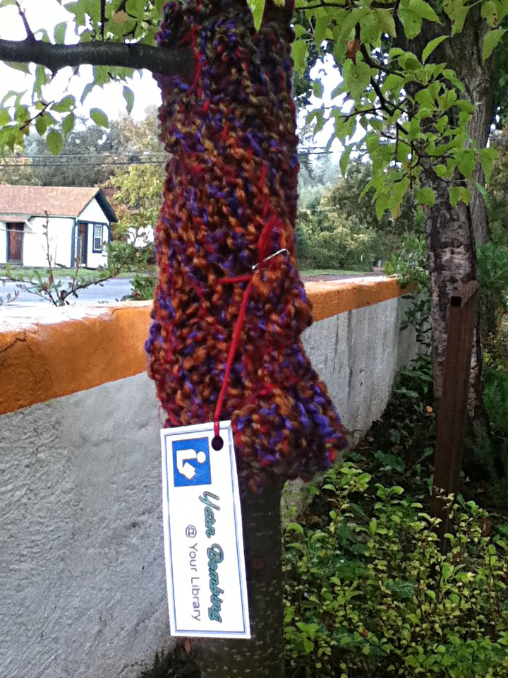 "Loom-knit tree sweater with tag: ""Yarn Bombing @ Your Library"""