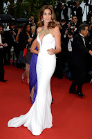 Cindy Crawford on the red cartep in a revealing white gown