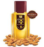 Menyembuhkan Lingkar Hitam Di Bawah Mata dengan minyak almond