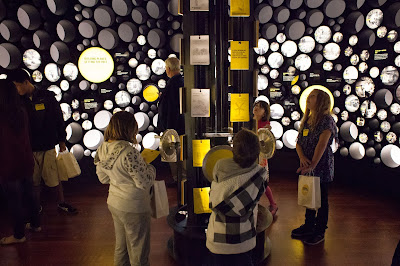 Schoolchildren explore an installation during a launch event for the Bezos Center for Innovation at the Museum of History and Industry in Seattle, Washington.