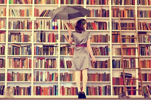 Woman perusing bookshelves