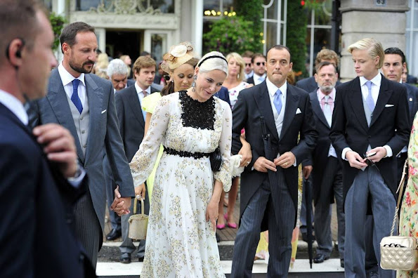 Crown Princess Mette-Marit of Norway and Crown Prince Haakon of Norway leave the Hotel Des Iles Borromees for the religious wedding ceremony of Pierre Casiraghi, Prince Albert II of Monaco's nephew, with Beatrice Borromeo