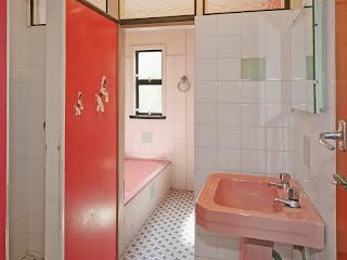 vintage 1960s bathroom with pink bath