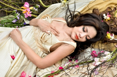 "Image ""Young Beautiful Woman Sleeping With Flowers Outdoor"" courtesy of Just2shutter at www.freedigitalphotos.net"