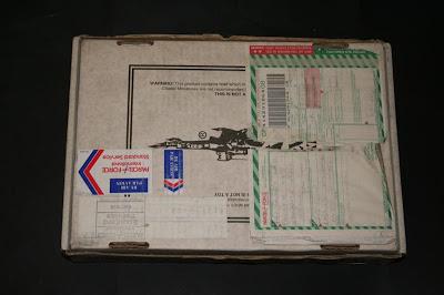 Dorso de la caja Telescópica de Games Workshop 24x35x7 cm