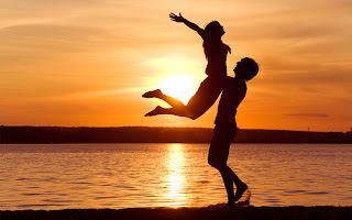 Love Couple Enjoying in Sunset