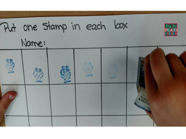 photo of student stamping into boxes on a worksheet
