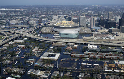 An aerial view from a United States Navy helicopter showing floodwaters around the Louisiana Superdome and surrounding area