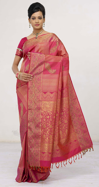wedding sarees, kanchipuram silk sarees,Kanch Pattu Saree,New Indian Designer Collection of Bridal Sarees ,Cotton Sarees, Cotton Designer Saris,Cotton Sarees,bridal saree, wedding sari, party wear sarees, traditional indian sarees like zari, silk, printed,A perfect example of a traditional kanchipuram sari with a traditional look..yet elegant and stylish. I would love to accesorize like the lady in the picture above if I wear a Kanchipuram sari.. The pallu of this sari is really gorgeous with a lady standng in a red sari all hand woven and this sari is a very expensive one..I guess it costs more than  I simply adore this sari for its beautiful combination of colour, Orange and purple I'm still hunting for this combination but could not get the exact combination. This is simply adorable!!! another sari from RMKV silks.  This is a readymade sari for your little angel. This is a pure kanchipuram silk sari customized as a ready to wear outfit for small kids. I'm sure your little one's will be excited to wear this kutti pattu.. means saree for kid  The sari above is called the muppagam pattu the latest trend in Kanchipuram saris. You can see the border of the sari and the body in almost the same width. This sari is from Mahaveers a popular shop in Coimbatore THIS ONE IS A GADHWAL SILK, MY FAVOURITE BLUE.MY MOM IN LAW GIFTED ME. Sarees are the elegant and the sexiest outfit for Indian women. A lady looks very graceful and elegant in a saree.There are wide range of sarees in different materials and designs and work. The designer crepe,georgette and chiffons are popular these days and when it comes to a formal occassion my personal choice definitely would be traditional sarees specially kanchivaram sarees.One can choose kanchivaram sarees as per their own taste.The variety ranges from simple,elegant sarees to a very grand saree and the price range vary with the zari work in the saree. A simple saree with minimum zari work will cost any where between 3000 to 4500 INR, and th
