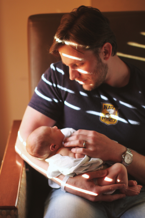 Pictures from the hospital: new dad and newborn baby boy