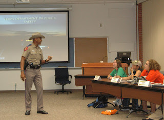 A Texas State Trooper talks to the class.