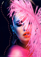 Cheryl Cole holding a pink feather