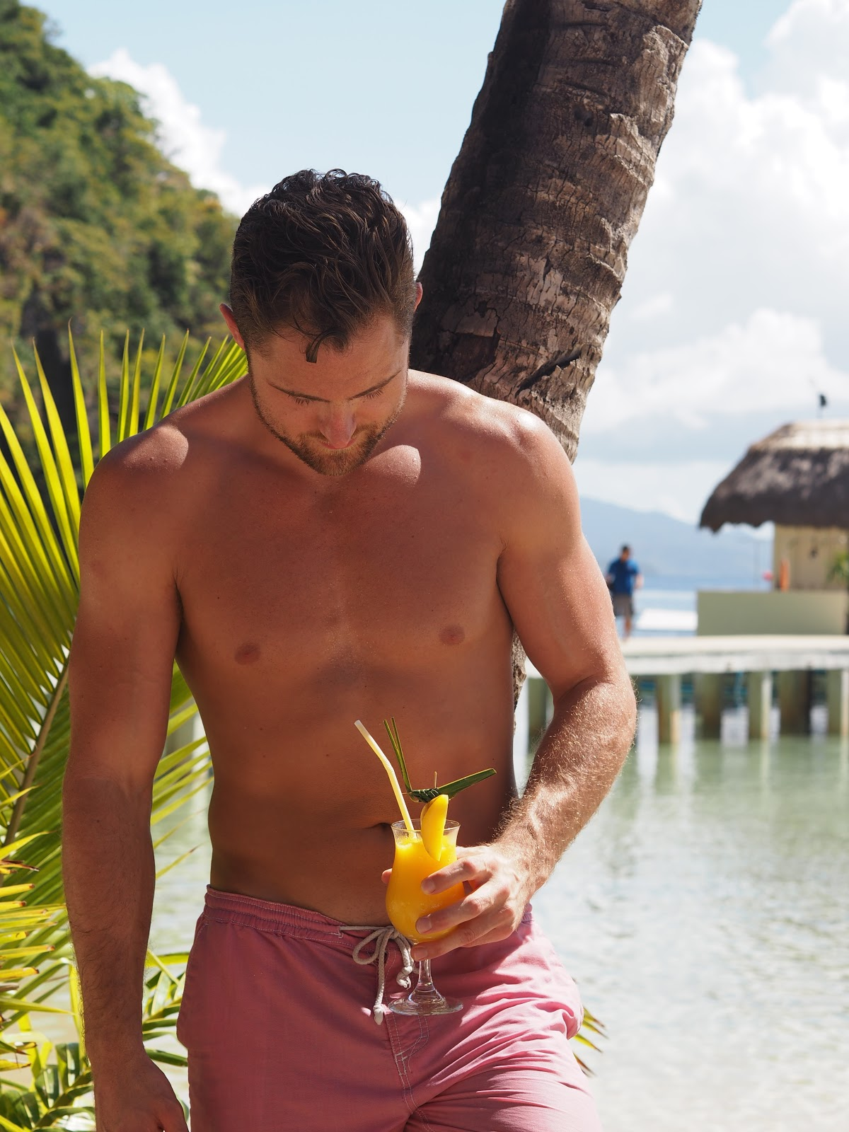man with tropical drink in paradise