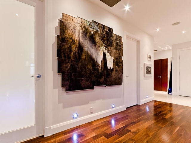 Picture of hallway with painting on the wall