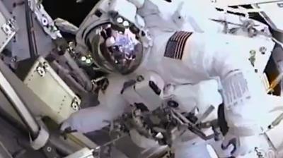 Spacewalk on day 5, retrieving experiments. NASA 2011.