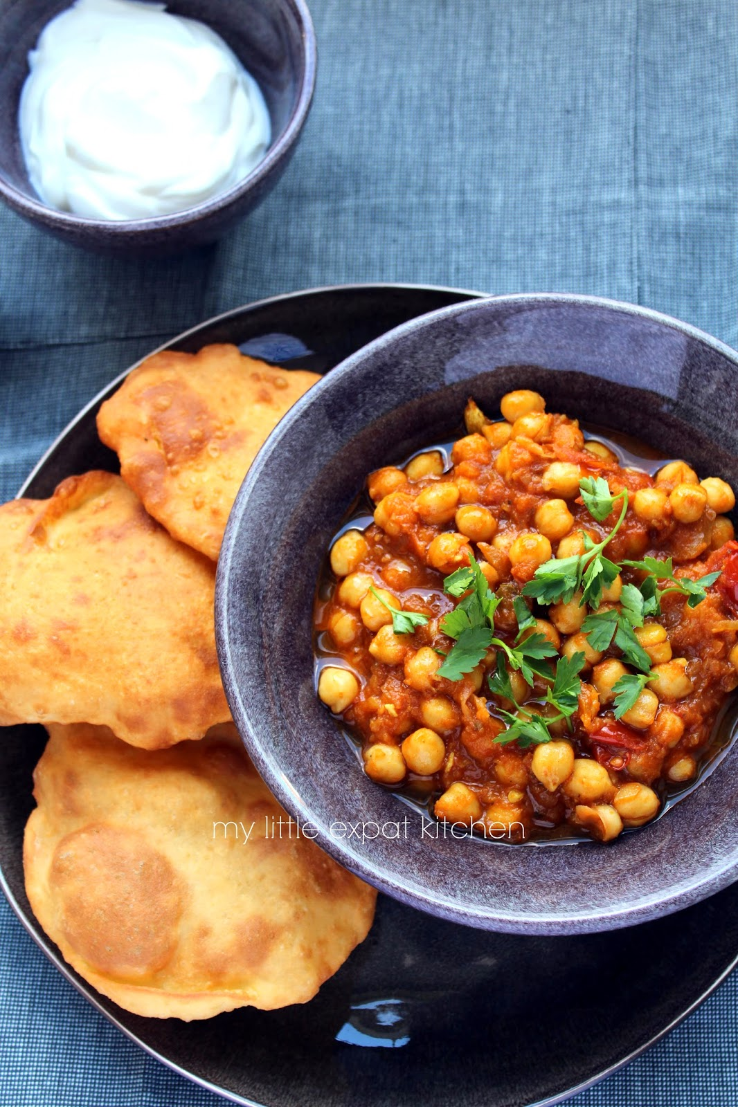 chole bhature (indian spicy chickpea stew and indian puffed fried bread)