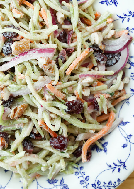 Sweet and Tangy Broccoli Slaw is a light summer side perfect for any occasion! - get the recipe at barefeetinthekitchen.com
