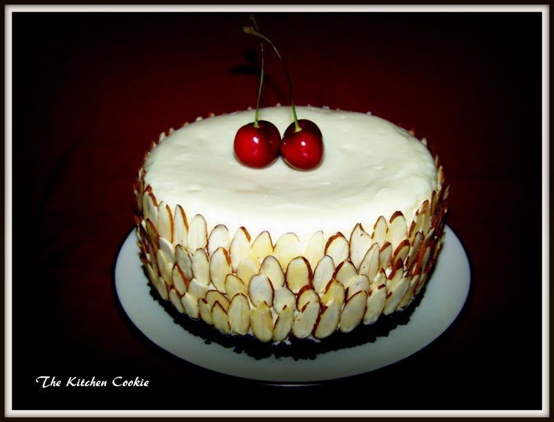 ... : White Choclate Almond Cheesecake with Black Cherry Sauce