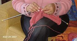 Eu tricotando