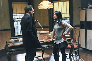 Jonny Lee Miller as Sherlock Holmes and Lucy Liu as Joan Watson in Elementary Episode # 12 M