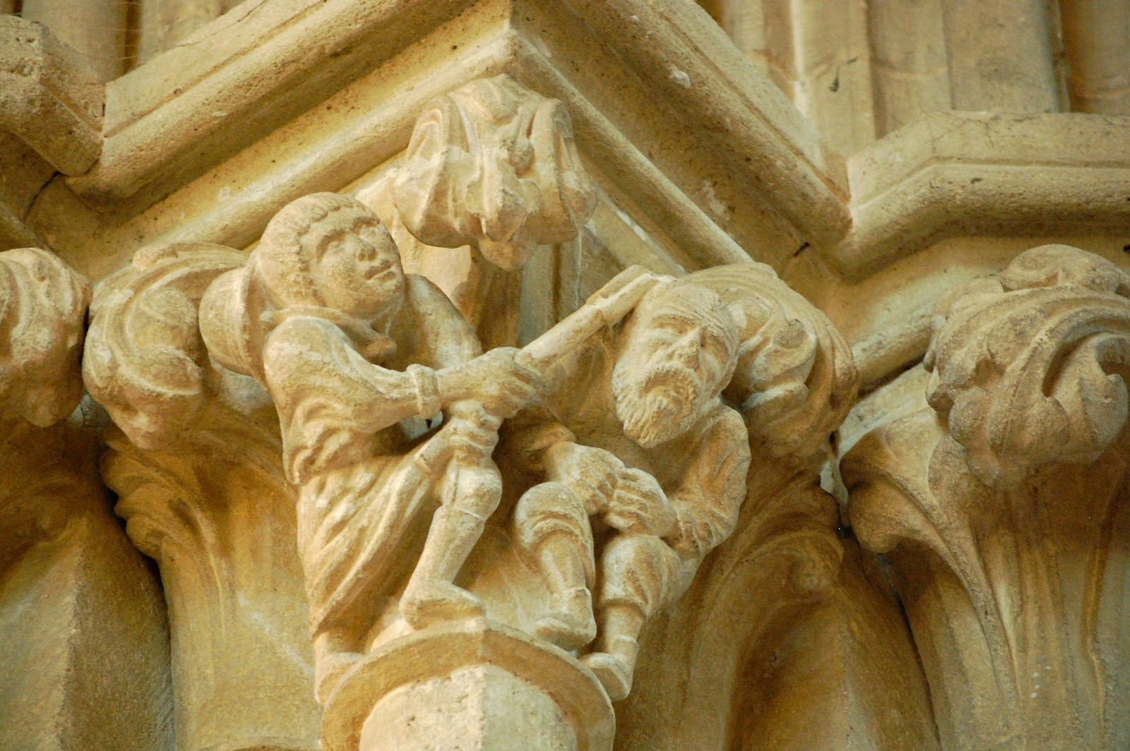 Carving of farmer smacking thief with pitchfork
