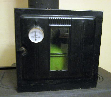 It has two removable grates inside (similar to a conventional oven), an  open floor and an oh-so-accurate temp gauge in the front door, reading