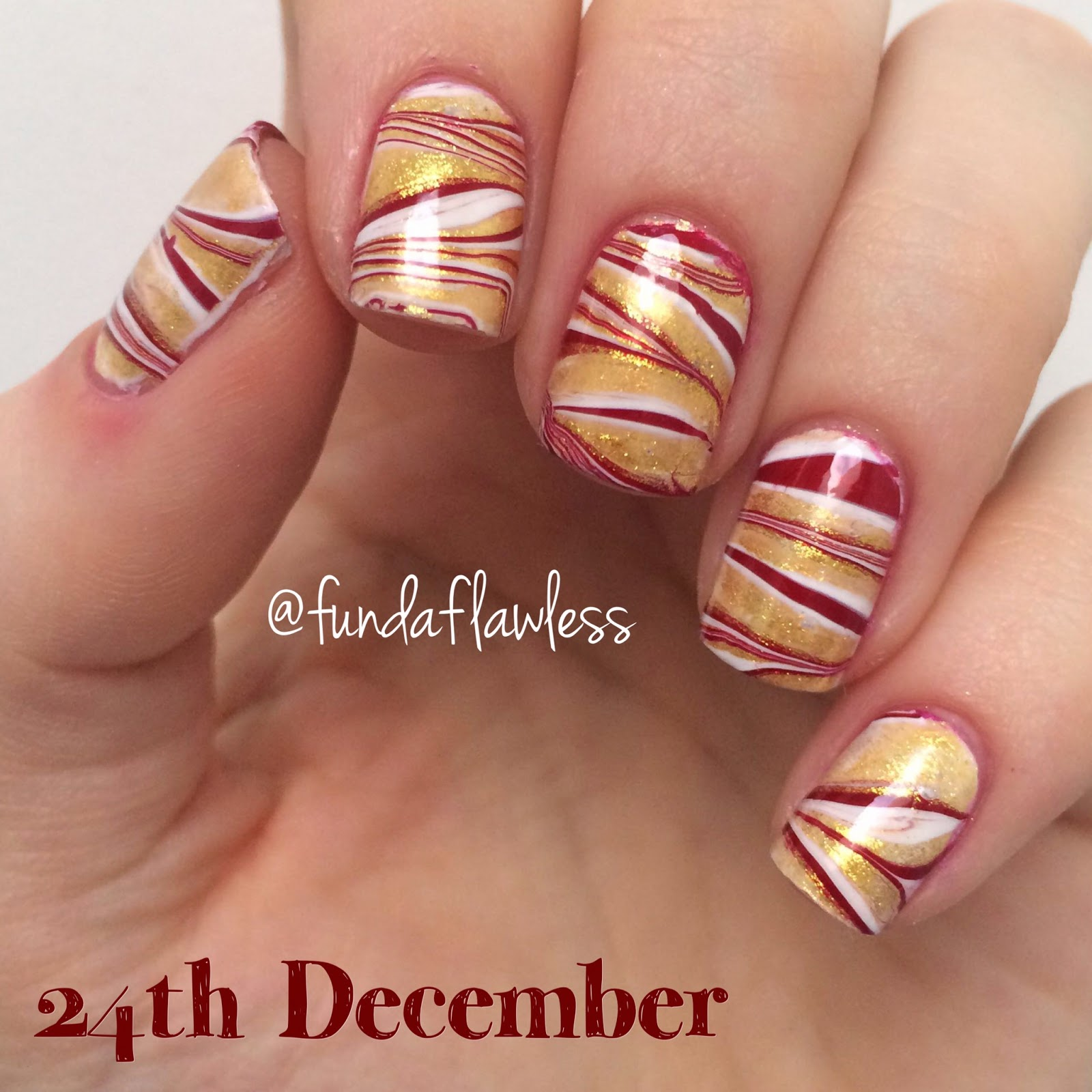 Gold, red and white watermarble nail art