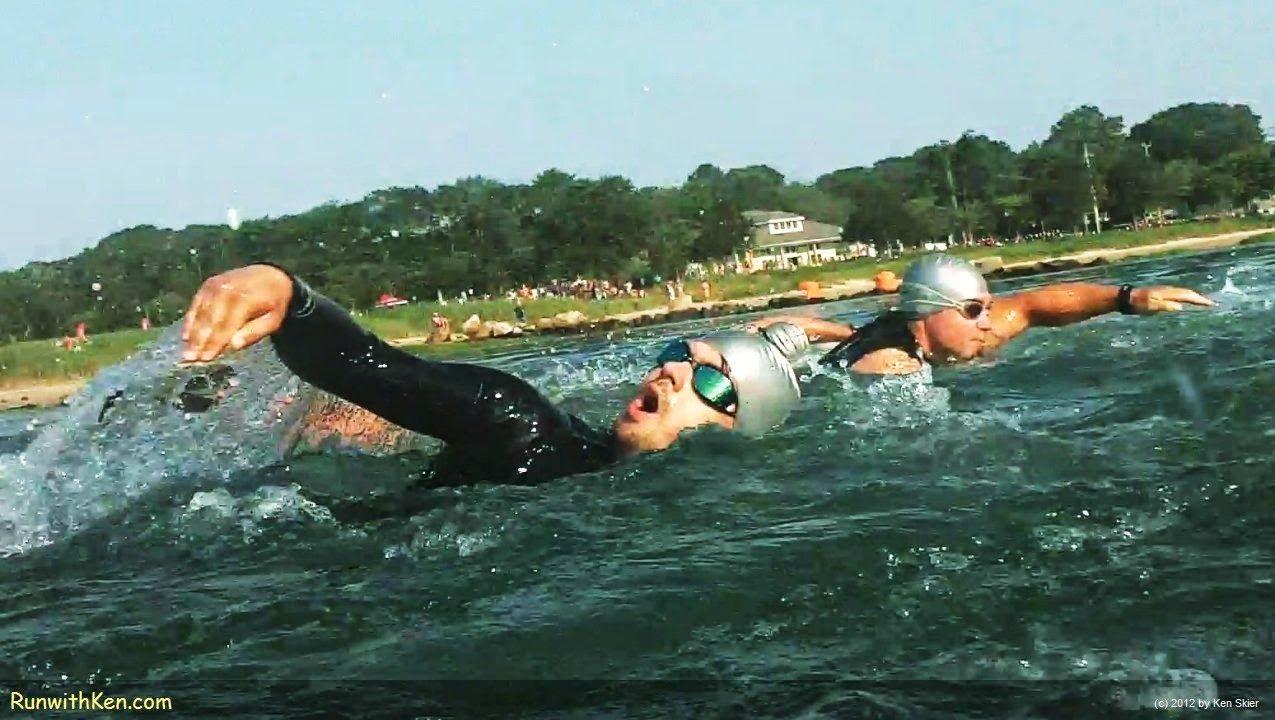 Up-close action photo of open water swimmers , swimming at the Whaling City Triathlon in New Bedford, MA, July 1, 2014.  Photo by Ken Skier, the Swimming Photographer.  (RunwithKen.com)  The Whaling City Triathlon is produced by Sun MultiSport Events.  (sunmultisportevents.com)