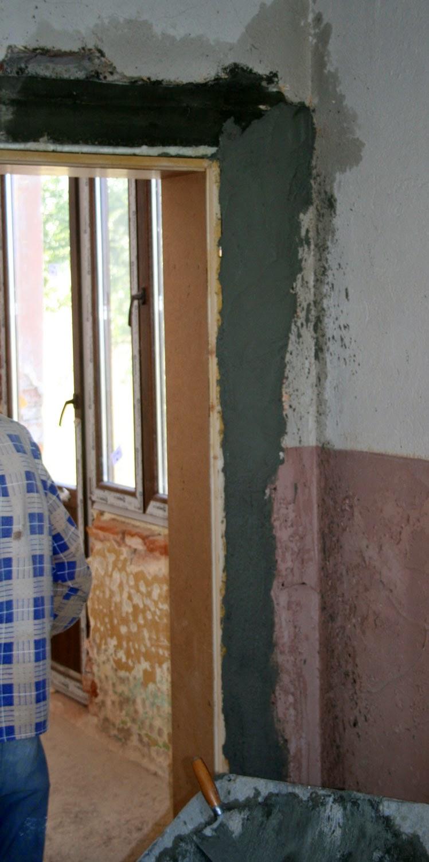 The door is plastered in