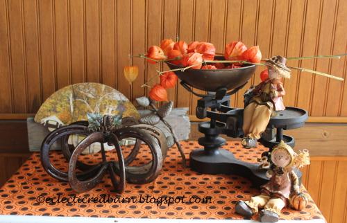 Fall vignette with horse shoe pumpkin
