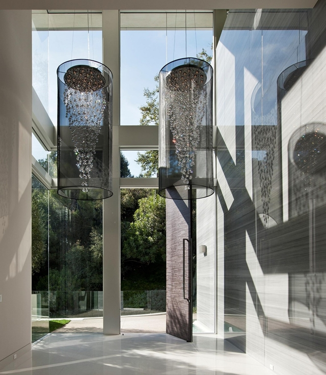 High modern glassy entrance into the modern home in Los Angeles