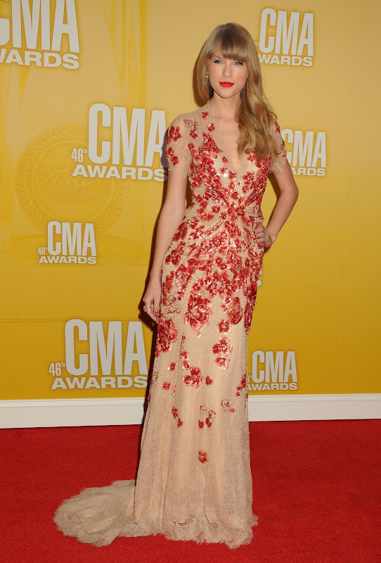 Taylor Swift in a floor lenght gown on the red carpet