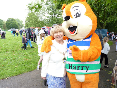 The Harold Hill Festival mascot is Harry the Squirrel. Here he is at this year's festival in Central Park, Harold Hill with the Mayor.