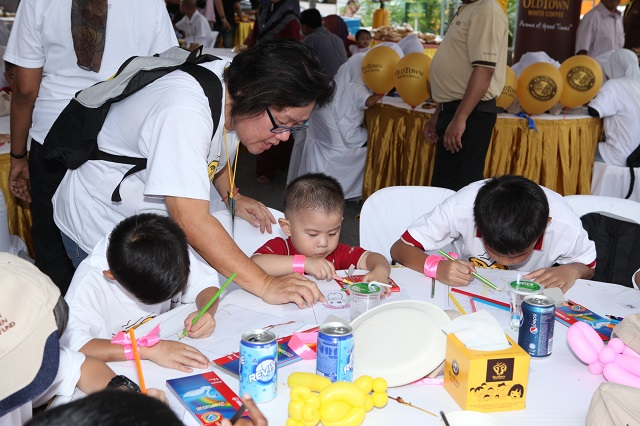 Kids competing to give their best at a colouring competition