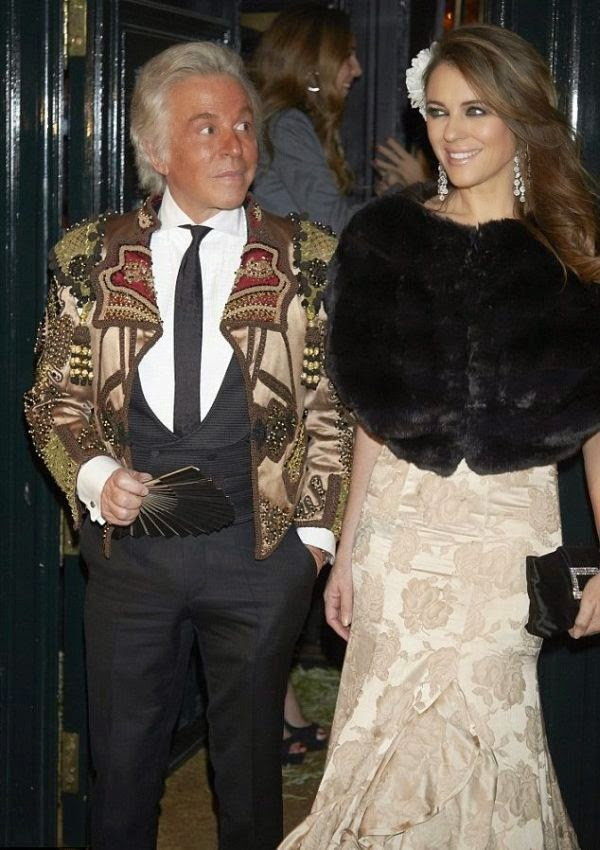 the 49-year-old, Elizabeth Hurley kicking a perfect art to the party with Valentino and Giancarlo Giammetti at Madrid, Spain on Friday, February 6, 2015.
