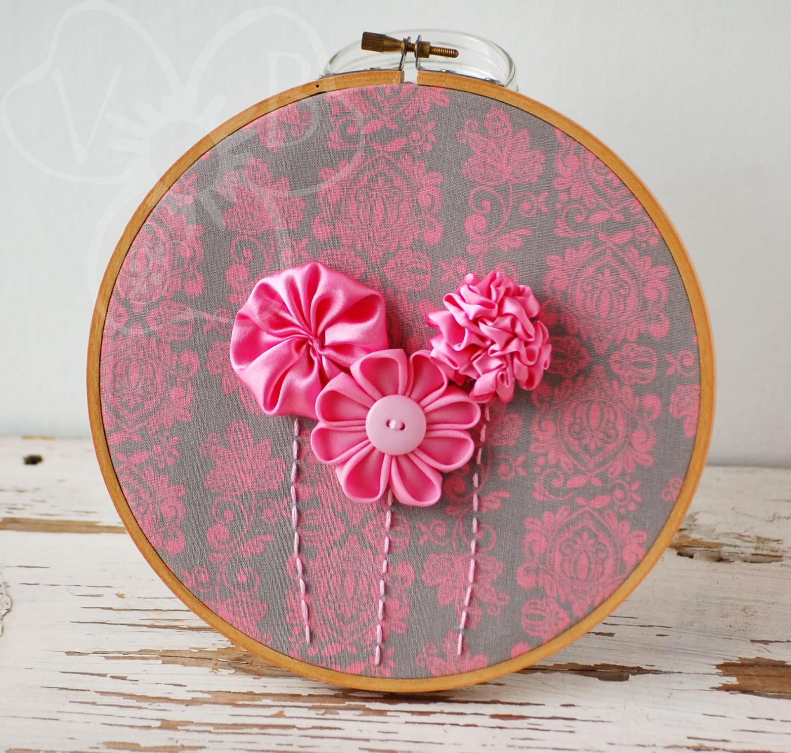 http://violetsbuds.storenvy.com/collections/500953-hoop-art/products/4618228-pink-bouquet-handmade-flower-hoop-art