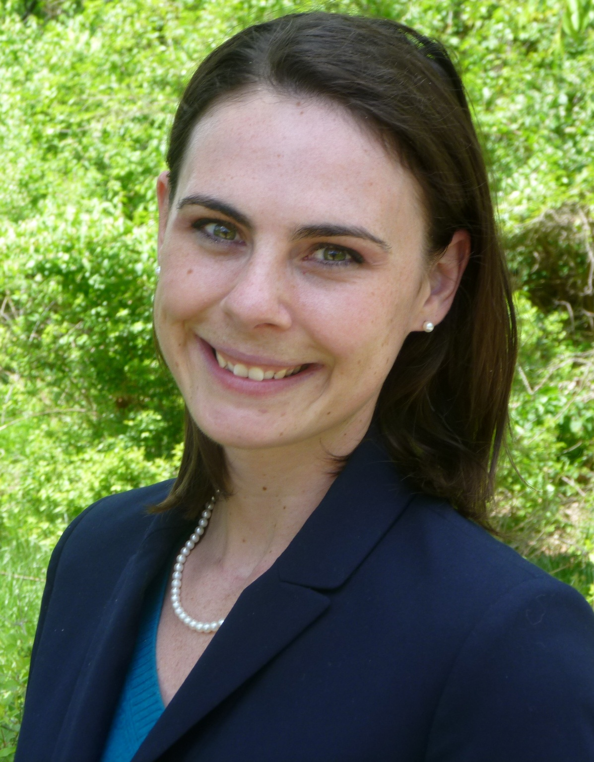 Headshot photo of Britt Ehrhardt in a suit jacket