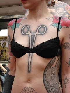 Scissors In The Middle Of Breast Tattoos