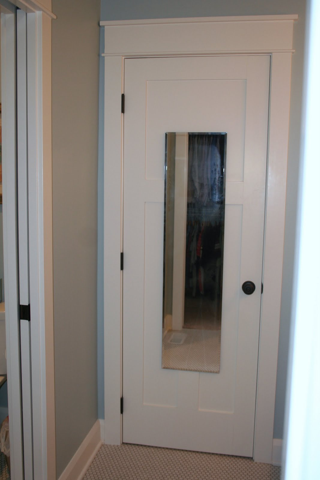 Stuck on hue hanging a full length mirror in the bathroom for Bathroom entrance doors