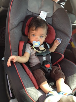 Elijah and his big boy carseat!
