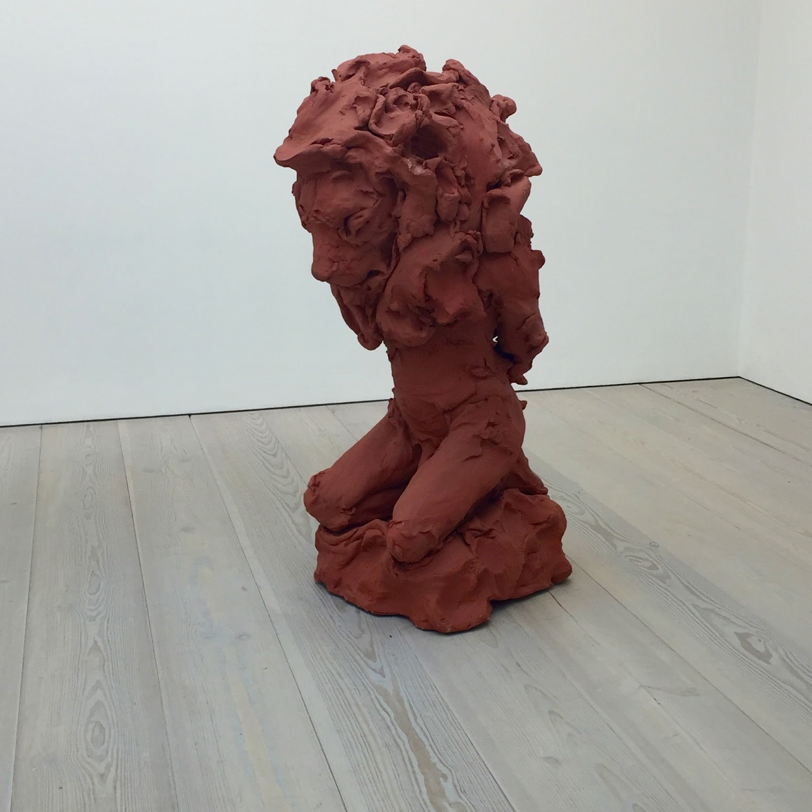statue made out of clay of man with lion head
